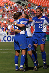 22 June 2003: Mia Hamm (9) and Jacqui Little embrace as Abby Wambach (28) joins the celebration after Hamm tied the game 1-1 with her 35th minute goal. The Washington Freedom tied the San Jose CyberRays 2-2 at RFK Stadium in Washington, DC in a regular season WUSA game.