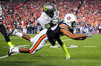 Jan 10, 2011; Glendale, AZ, USA; Oregon Ducks cornerback Cliff Harris (13) intercepts a pass intended for Auburn Tigers wide receiver Emory Blake (80) during the first half of the 2011 BCS National Championship game at University of Phoenix Stadium.  Mandatory Credit: Mark J. Rebilas-