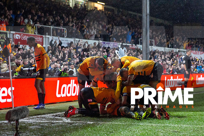 Newport County players celebrate their side's first goal during the FA Cup 4th round replay match between Newport County and Middlesbrough at Rodney Parade, Newport, Wales on 5 February 2019. Photo by Mark  Hawkins / PRiME Media Images.