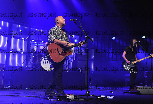 PIXIES - vocalist Black Francis and bassist Kim Shattuck - performing live on Day 25 of the iTunes Festival at The Roundhouse in London UK - 25 Sep 2013.  Photo credit: George Chin/IconicPix
