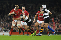 Wales Aaron Wainwright is tackled by Barbarians Marco Van Staden<br /> <br /> Photographer Ian Cook/CameraSport<br /> <br /> 2019 Autumn Internationals - Wales v Barbarians - Saturday 30th November 2019 - Principality Stadium - Cardifff<br /> <br /> World Copyright © 2019 CameraSport. All rights reserved. 43 Linden Ave. Countesthorpe. Leicester. England. LE8 5PG - Tel: +44 (0) 116 277 4147 - admin@camerasport.com - www.camerasport.com