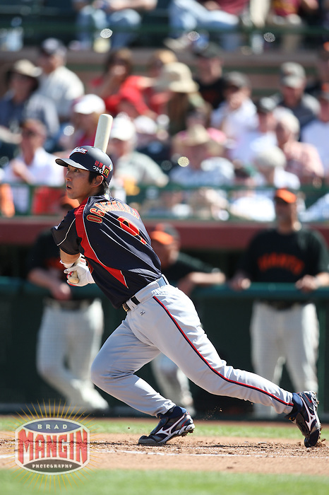 SCOTTSDALE, AZ - MARCH 11: Michihiro Ogasawara of Japan bats during the exhibition game against the San Francisco Giants at Scottsdale Stadium in Scottsdale, Arizona on March 11, 2009. Japan defeated the Giants 6-4. Photo by Brad Mangin