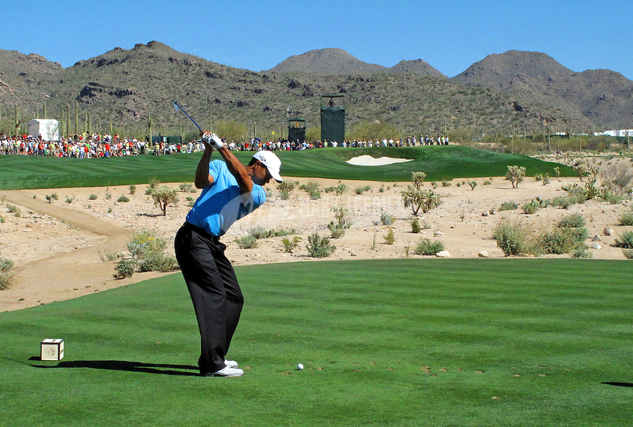 Feb 25, 2009; Marana, AZ, USA; Tiger Woods tees off on the sixth tee against Brendan Jones (not pictured) during the first round of the World Golf Championships-Accenture Match Play Championship at the Ritz-Carlton Golf Club, Dove Mountain. Woods defeated Jones in 16 holes to advance to the second round. Mandatory Credit: Mark J. Rebilas-