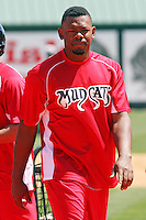 Denis Phipps #22 of the Carolina Mudcats around the batting cage before  a game against the Montgomery Biscuits on April 18, 2010 in Zebulon, NC.
