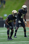 Essang Bassey (21) and Cameron Glenn (2) of the Wake Forest Demon Deacons on defense during first half action against the Louisville Cardinals at BB&T Field on October 28, 2017 in Winston-Salem, North Carolina.  The Demon Deacons defeated the Cardinals 42-32.  (Brian Westerholt/Sports On Film)