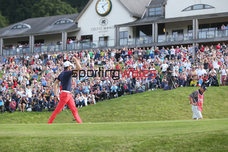 ISPS Handa Wales Open 2013<br /> Gregory Bourdy sinks his birdie putt on the 18th green to win the tournament in front of spectators packing the hill outside the Twenty Ten clubhouse.<br /> 01.09.13<br /> <br /> &copy;Steve Pope-Sportingwales