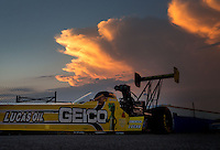 Aug. 30, 2013; Clermont, IN, USA: The car of NHRA top fuel dragster driver Morgan Lucas is towed back to the pits as the sun sets during qualifying for the US Nationals at Lucas Oil Raceway. Mandatory Credit: Mark J. Rebilas-