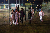 Pictured: Players walk around the Cardiff Athletics Stadium. Saturday 29 March 2014<br /> Re: Cardiff thrill-seekers were chased around the city last night by a horde of terrifying zombies as part of virtual apocalypse game 2.8 Hours Later.<br /> Starting in Grangetown, groups of zombie-enthusiasts walked, jogged, hid and run around a quarantined area of the city, which included Cardiff City Stadium and Ninian Park Primary School, to escape a deadly mass of infected undead.<br /> But it wasn't just zombies threatening to disturb the peace of the city – aggressive police and surveillance squads forcing people to stand up against walls and avoid their harmless friends for fear of spreading infection wreaked havoc in the quarantine.