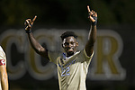 Ema Twumasi (22) of the Wake Forest Demon Deacons celebrates after scoring his second goal of the game during second half action against the Clemson Tigers at Spry Soccer Stadium on September 29, 2017 in Winston-Salem, North Carolina.  The Demon Deacons defeated the Tigers 3-2 in 2OT.  (Brian Westerholt/Sports On Film)