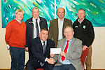 Padraig Firtear of Pobalscoil Chorca Dhuibhne with a cheque from Chapter 21Credit Union presented by Kerry County GAA board,  chairman Patrick O'Sullivan at the Manor West Hotel on Thursday. Pictured Patrick O'Sullivan, Padraig Ferthair, Dermot Lynch,John O'Regan, Jack Harrington and Paudie Dineen