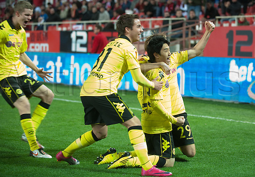 Dortmund's Sven Bender (L-R), Mario Goetze, scorer Shinji Kagawa and Marcel Schmelzer (hidden) celebrate the first goal for 1:0 during the UEFA Europa League group J match between Sevilla FC and Borussia Dortmund at Stadion Ramon Sanchez Pizjuan in Sevilla, Spain, 15 December 2010.