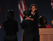 Chicago, IL - November 4, 2008 -- United States President-elect Barak Obama picks-up his daughter, Sasha, after speaking in Lower Hutchinson Field, Grant Park, Chicago, Illinois after his election as President of the United States on Tuesday, November 4, 2008..Credit: Ron Sachs / CNP.(Restriction: No New York Metro or other Newspapers within a 75 mile radius of New York City)