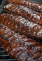 Barbequed pork ribs on a gas grill ready for serving.