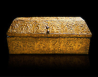 Gothic embossed Brass on wood box, circa 1370-1450, possibly made in Barcelona, Catalunya. National Museum of Catalan Art, Barcelona, Spain, inv no: MNAC 5361. Against a black background.