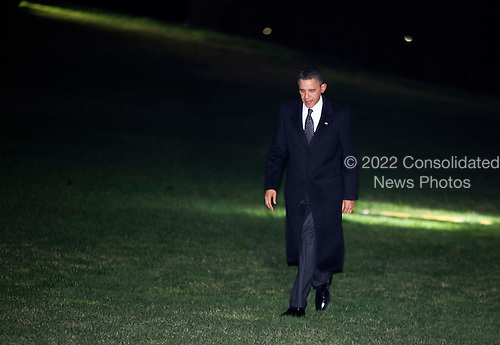 United States President Barack Obama walks from Marine One to the White House in Washington, D.C., U.S., on Tuesday, March 29, 2011. .Credit: Joshua Roberts / Pool via CNP