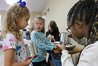NWA Democrat-Gazette/DAVID GOTTSCHALK Kamrin Thornton (from right), counselor, uses a glue gun to assist Leot (cq) Cochran, 6, and Lylia Erickson, 6, with decorating their flower pots Wednesday, March 20, 2019, as they participate in Spring Break Camp at Mount Sequoyah in Fayetteville. The weeklong camp offers different themed activities each day that includes Detectives, Sports, Science/Tech along with free time activities. Campers can register for a day or multiple days.