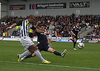 Stuart Kettlewell fails to intercept the cross of Josh Magennis in the St Mirren v Ross County Scottish Professional Football League Premiership match played at St Mirren Park, Paisley on 3.5.14.