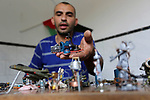 """Palestinian artist Magdy Abu Takeya, 38, converts gunshots used by the Israeli security forces against Palestinian protesters to small pieces of art knows as """"Art of thumbnails"""" at his house in Nuseirat in the central Gaza Strip, on April 25, 2018. Photo by Ashraf Amra"""