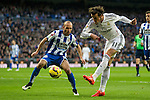 Real Madrid´s Gareth Bale and Deportivo de la Coruna's Laureano Sanabria Ruiz during 2014-15 La Liga match between Real Madrid and Deportivo de la Coruna at Santiago Bernabeu stadium in Madrid, Spain. February 14, 2015. (ALTERPHOTOS/Luis Fernandez)