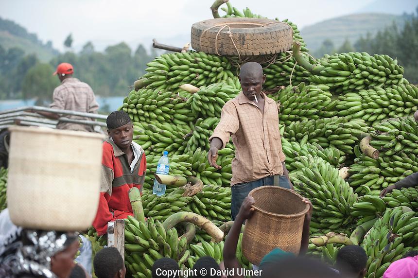 Banana man selling from heavily laden truck in Kisoro market, Uganda.