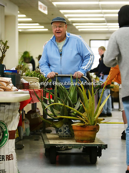 WATERBURY, CT 4/01/07- 040107BZ07- Robert Kullberg moves a cart with Aloe plants at the 24th annual Connecticut Cactus and Succulent Society Show and Sale at Naugatuck Valley Community College in Waterbury Sunday.<br /> Jamison C. Bazinet Republican-American