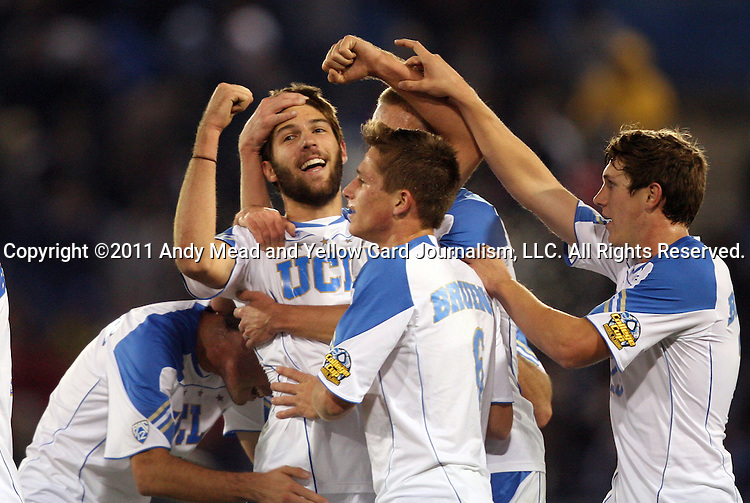 09 December 2011: UCLA's Ryan Hollingshead (left) celebrates his goal with Matt Wiet (6) and Joe Sofia (27). The University of California Los Angeles Bruins played the University of North Carolina Tar Heels to a 2-2 tie after overtime, with the Tar Heels advancing with a 3-1 win in the penalty kick shootout at Regions Park in Hoover, Alabama in an NCAA Division I Men's Soccer College Cup semifinal game.