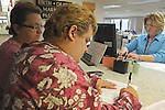(L-r) Sandra Quandt, 48, and Rebecca Bird, 41, review their marriage license as vital records clerk Rebecca Badtram all from Davenport, Iowa, makes corrections at the Scott County Recorder's Office the first day same sex weddings are legal across Iowa in Davenport, Iowa on April 27, 2009.