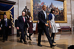 President Barack Obama and First Lady Michelle Obama walk through the US Capitol Rotunda to the inaugural luncheon, January 21, 2013 in Washington, D.C.