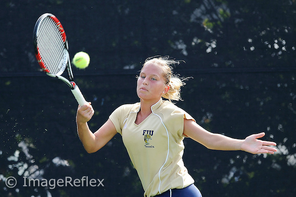 9 November 2008:  FIU's Maria Spenceley returns the ball during her match against Miami's Claudia Wasilewski during the final day of the University of Miami Fall Invitational tournament at the Neil Schiff Tennis Center in Coral Gables, Florida.  Wasilewski defeated Spenceley, 3-6, 6-3, 6-0.