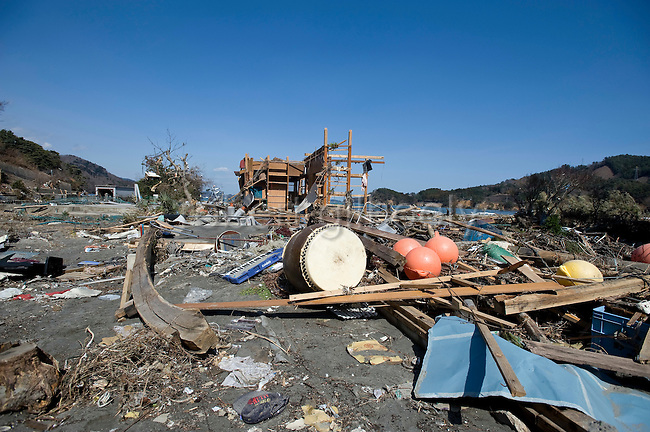 Photo shows the battered battered remains of a community on the Oshika Peninsula, Miyagi Prefecture, Japan on 19 March, 2011.  Photographer: Robert Gilhooly