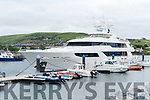 A yacht towering over the other boats at the Dingle marina.