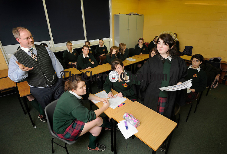 Pupil Odharna Ní Dhomhnalláin tries on the wig and gown during a simulation of a court scene with Barrister James Fahey of the Western Circuit Court, during his visit to Scoil Mhuire, Ennistymon. Photograph by John Kelly.