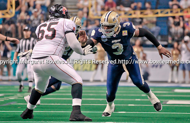 Aug 14, 2010: Tampa Bay Storm defensive lineman Kelvin Kinney (#3) tangles with Orlando Predator offensive lineman Christopher Jamison (#65). The Storm defeated the Predators 63-62 to win the division title at the St. Petersburg Times Forum in Tampa, Florida. (Mandatory Credit:  Margaret Bowles)