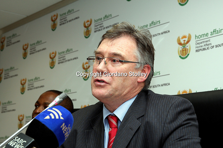 PRETORIA - 11 November 2011 - Murray Michell, the head of the Financial Intelligence Centre (FIC), addresses a press conference where it is announced that refugees and those granted asylum will be allowed to open bank accounts, using their refugee and asylum papers. The FIC is a South African statutory body that enforces regulations to prevent financial crimes such as money laundering. -- APP/Allied Picture Press