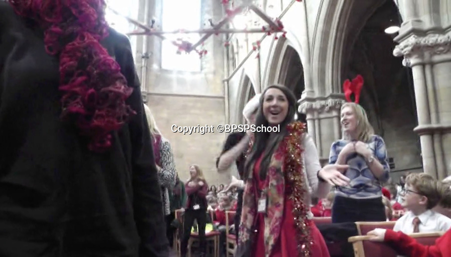 BNPS.co.uk (01202 558833)<br /> Pic: BPSPSchool/BNPS<br /> <br /> Singing teachers join in.<br /> <br /> Xmas cheer...<br /> <br /> A heartwarming performance from the hit movie Frozen has delighted primary school children in Poole Dorset - after teachers burst into song during a Xmas service in St Peters church in the town.<br /> <br /> Head teacher Paul Howieson led the staff in the impromptu performance, and even the vicar joined in as the children clapped along.<br /> <br /> Paul said 'The kids have all worked really hard through the year and we thought we would give them a Xmas service to remember.- they certainly seemed to enjoy it'.