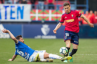 SADAR, PAMPLONA, SPAIN: La Liga de Fútbol, ​​CA Osasuna vs Tenerife; Alberto, player of Tenerife, takes a ball from Kike Barja during the game of the League 123, on April 1, 2018