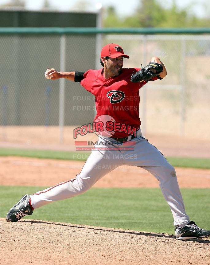 Eric Smith #43 of the Arizona Diamondbacks pitches in a minor league spring training game against the Colorado Rockies at the Rockies minor league complex on April 1, 2011  in Scottsdale, Arizona. .Photo by:  Bill Mitchell/Four Seam Images.
