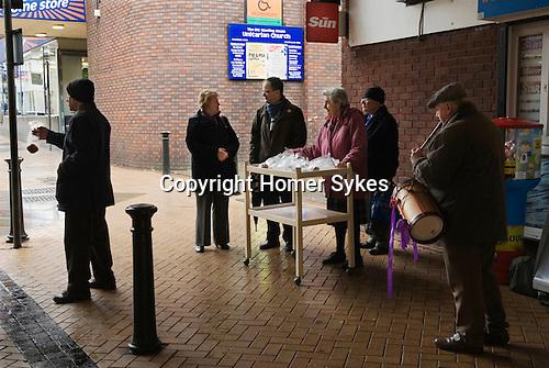 Mary Mallatratt, Hot Cross Bun Legacy. Good Friday, annually Mansfield Nottinghamshire. Unitarian Church members distribute 48 Hot Cross Buns in the Four Seasons shopping centre.