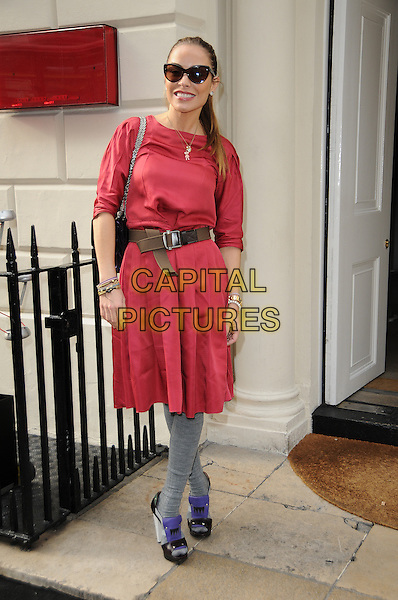 ELEN RIVAS .At Hello Kitty's 35th Anniversary Party, Sketch, London, England, UK,.29th October 2009..full length red dress waist belt grey gray tights purple black patent shoes heels open toe platform bracelets brown sunglasses hair up ponytail smiling .CAP/CAS.©Bob Cass/Capital Pictures