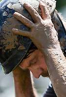 NWA Democrat-Gazette/CHARLIE KAIJO Clay Bowman of Bella Vista removes his muddy helmet after a ride during the Mudtown Days event, Saturday, June 8, 2019 at Ward Nail Park in Lowell. <br />