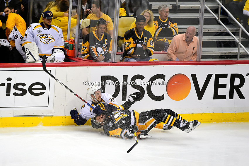 May 29, 2017: Nashville Predators right wing Viktor Arvidsson (38) takes down Pittsburgh Penguins defenseman Trevor Daley (6)  during game one of the National Hockey League Stanley Cup Finals between the Nashville Predators  and the Pittsburgh Penguins, held at PPG Paints Arena, in Pittsburgh, PA. Pittsburgh defeats Nashville 5-3 in regulation time.  Eric Canha/CSM