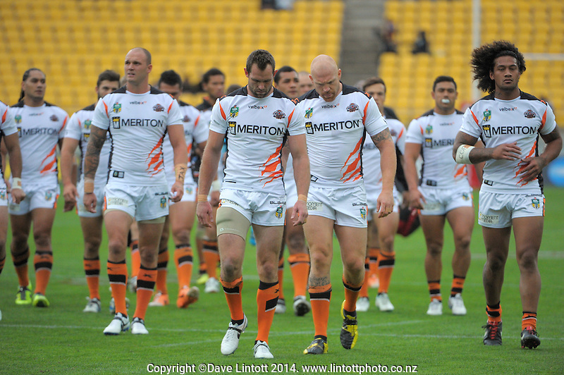 The Tigers walk in after warmup before the NRL match between the NZ Warriors and Wests Tigers at Westpac Stadium, Wellington, New Zealand on Saturday, 29 March 2014. Photo: Dave Lintott / lintottphoto.co.nz