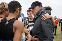 Colorado cross country coach Mark Wetmore congratulates his team after they won the national title during the NCAA Cross Country Championships in Terre Haute, Ind. on Saturday, Nov. 22, 2014. (James Brosher, Special to the Denver Post)