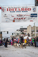 Paul Gebhardt and team leave the ceremonial start line with an Iditarider at 4th Avenue and D street in downtown Anchorage, Alaska during the 2015 Iditarod race. Photo by Jim Kohl/IditarodPhotos.com