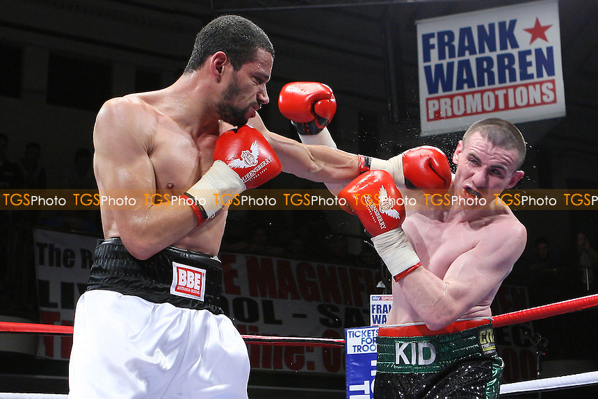 Peter McDonagh (green/black shorts) defeats Curtis Woodhouse in a Light-Welterweight boxing contest at York Hall, Bethnal Green, promoted by Frank Warren - 23/10/10 - MANDATORY CREDIT: Gavin Ellis/TGSPHOTO - Self billing applies where appropriate - Tel: 0845 094 6026