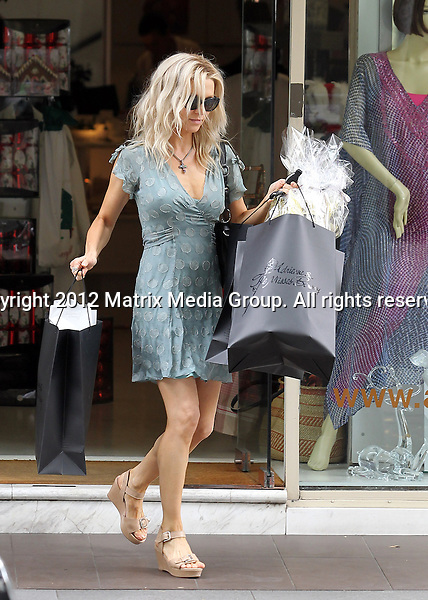 21 DECEMBER 2012 SYDNEY AUSTRALIA ..NON EXCLUSIVE ..With Russell Crowe now back in Australia Danielle Spencer seems to be showing Russell what he has been missing out on as she is pictured stepping out for some Christmas shopping in Double Bay in a short summer dress. Danielle showed off her petite svelte body and toned legs as she hurried out of a boutique with some bags of presents in a very feminine ensemble rather than her usual gym leggings and singlet....*No internet without clearance*.MUST CALL PRIOR TO USE ..+61 2 9211-1088.Matrix Media Group.Note: All editorial images subject to the following: For editorial use only. Additional clearance required for commercial, wireless, internet or promotional use.Images may not be altered or modified. Matrix Media Group makes no representations or warranties regarding names, trademarks or logos appearing in the images.