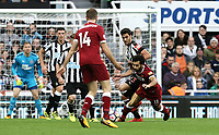 Liverpool's Mohamed Salah is fouled by Newcastle United's Mikel Merino who is shown a yellow card for his reaction to the free-kick decision<br /> <br /> Photographer Rich Linley/CameraSport<br /> <br /> The Premier League -  Newcastle United v Liverpool - Sunday 1st October 2017 - St James' Park - Newcastle<br /> <br /> World Copyright &copy; 2017 CameraSport. All rights reserved. 43 Linden Ave. Countesthorpe. Leicester. England. LE8 5PG - Tel: +44 (0) 116 277 4147 - admin@camerasport.com - www.camerasport.com