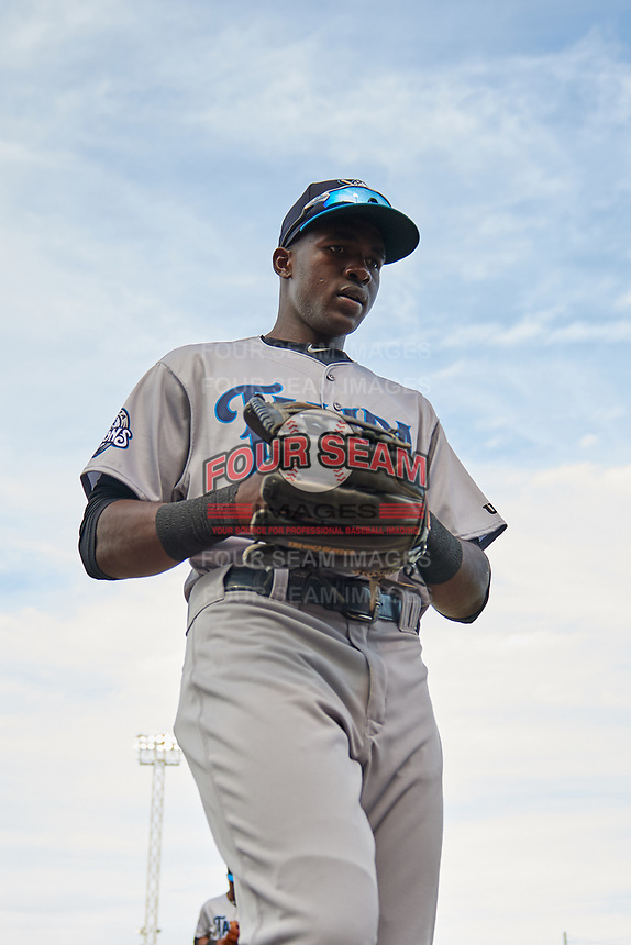 Tampa Tarpons center fielder Estevan Florial (34) returns to the dugout during a game against the Lakeland Flying Tigers on April 5, 2018 at Publix Field at Joker Marchant Stadium in Lakeland, Florida.  Tampa defeated Lakeland 4-2.  (Mike Janes/Four Seam Images)