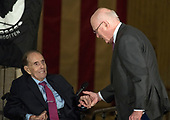 United States Senator Patrick Leahy (Democrat of Vermont), right, shakes hands with former US Senator Bob Dole (Republican of Kansas), left, after making remarks at a Congressional Gold Medal ceremony honoring Dole that was also attended by US President Donald J. Trump in the Rotunda of the US Capitol on Wednesday, January 17, 2017.  Congress commissioned gold medals as its highest expression of national appreciation for distinguished achievements and contributions.  Dole served in Congress from 1961 through 1996, was the Senate GOP leader from 1985 through 1996, and was the 1996 Republican Party nominee for President of the United States.<br /> Credit: Ron Sachs / CNP
