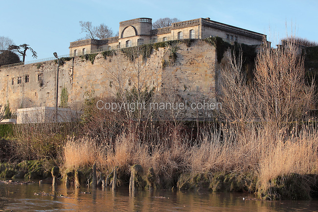 River bank, and the Chartreuse or Castle Citadel, built in the 18th century on the site of previous castles, behind the medieval fortified walls, in the ancient village of Bourg, built in Roman times at the confluence of the Dordogne and Garonne rivers, on the Gironde Estuary, Aquitaine, France. Picture by Manuel Cohenr/